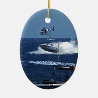 Powerboat and a helicopter ceramic oval ornament
