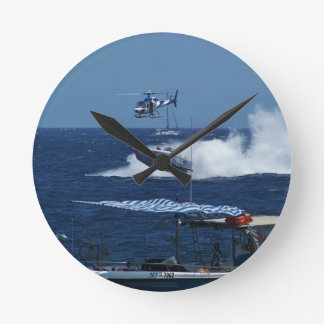 Powerboat and a helicopter clock