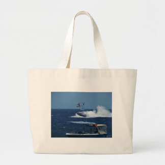 Powerboat and a helicopter large tote bag