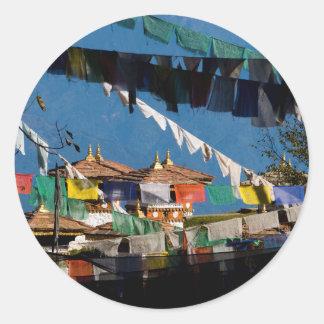 Prayer flags and chortens round sticker