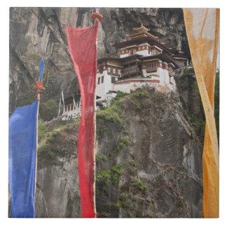 Prayer flags hang near Taktshang Tile