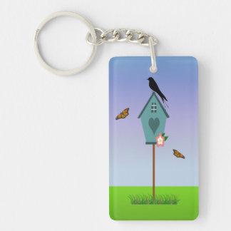 Pretty Bird Silhouette on top a Blue Birdhouse Single-Sided Rectangular Acrylic Keychain