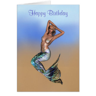 Pretty blonde mermaid laying on the beach card