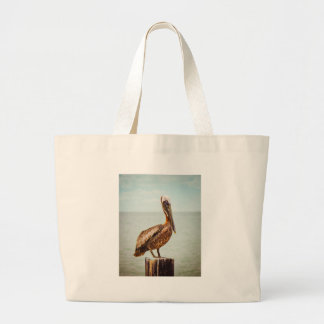 Pretty Pelican Perched Over the Ocean Large Tote Bag