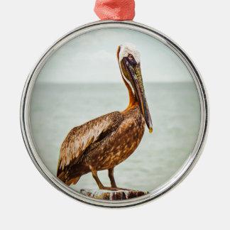 Pretty Pelican Perched Over the Ocean Metal Ornament
