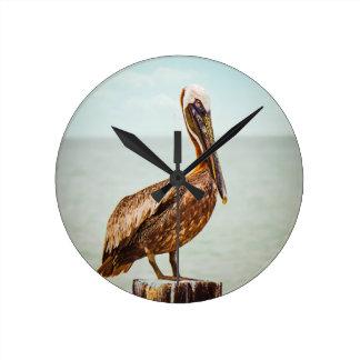 Pretty Pelican Perched Over the Ocean Round Clock