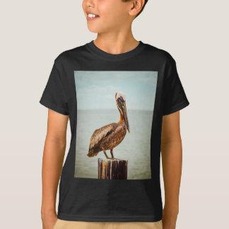 Pretty Pelican Perched Over the Ocean T-Shirt