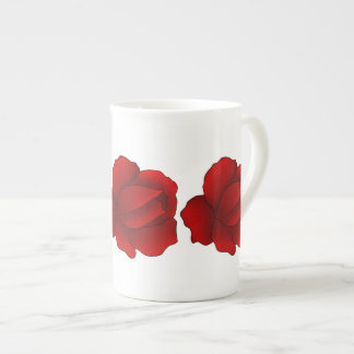 Pretty red roses on white tea cup