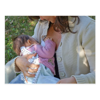 Pretty young brunette mum breastfeeding her baby postcard