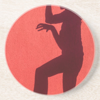 Profile shadow of woman on red wall coaster