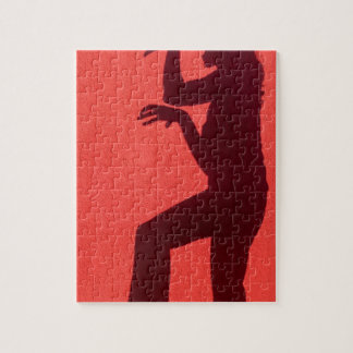 Profile shadow of woman on red wall jigsaw puzzle