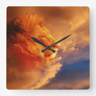 Proud male lion face in sunset clouds square wall clock