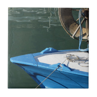 Prow of a wooden fishing boat with trawl winch ceramic tiles