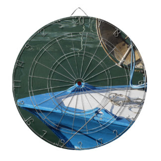 Prow of a wooden fishing boat with trawl winch dartboard