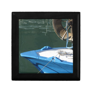 Prow of a wooden fishing boat with trawl winch jewelry box