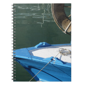 Prow of a wooden fishing boat with trawl winch notebooks