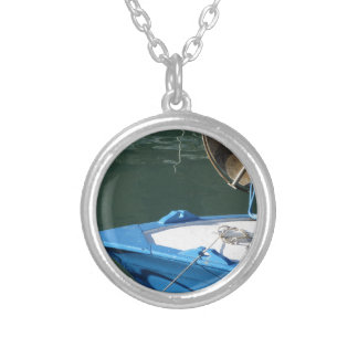 Prow of a wooden fishing boat with trawl winch silver plated necklace