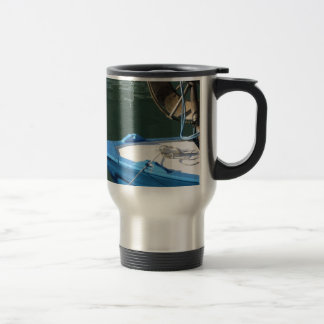 Prow of a wooden fishing boat with trawl winch travel mug