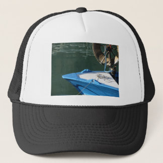 Prow of a wooden fishing boat with trawl winch trucker hat