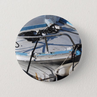Prow of fishing boat moored in the harbor 2 inch round button