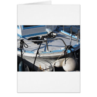Prow of fishing boat moored in the harbor card