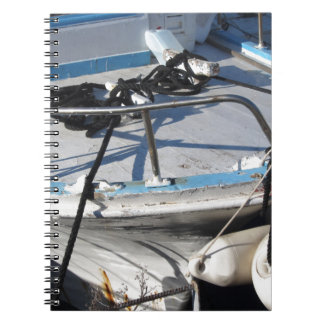 Prow of fishing boat moored in the harbor notebook
