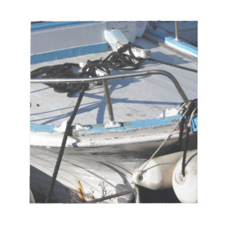Prow of fishing boat moored in the harbor notepad
