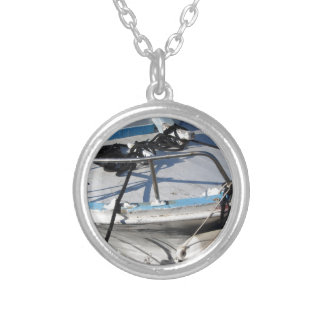 Prow of fishing boat moored in the harbor silver plated necklace