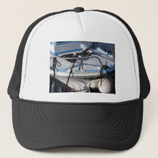 Prow of fishing boat moored in the harbor trucker hat