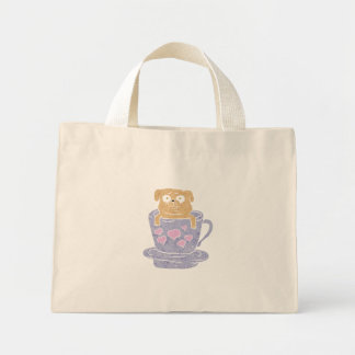 Pug dog sitting in purple  cup with heart. mini tote bag