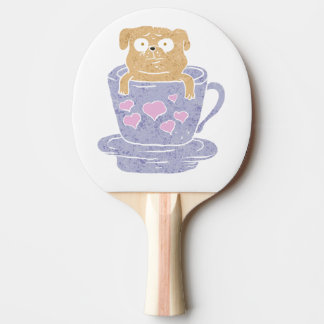 Pug dog sitting in purple  cup with heart. Ping-Pong paddle