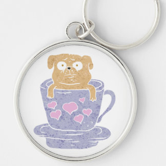 Pug dog sitting in purple  cup with heart. Silver-Colored round keychain