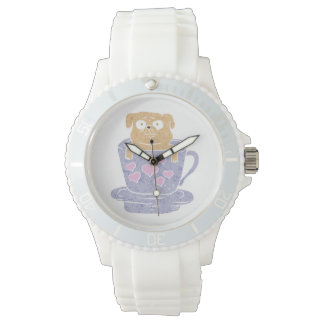 Pug dog sitting in purple  cup with heart. wristwatch