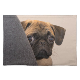 Pug peering around chair placemat