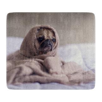Pug puppy Dog Cuddling in a warm towel Blanket Cutting Board