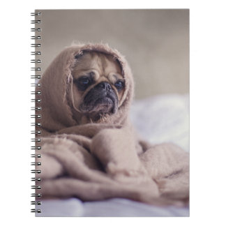 Pug puppy Dog Cuddling in a warm towel Blanket Notebook