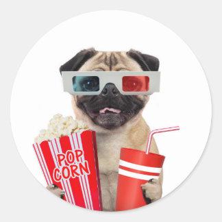 Pug watching a movie round sticker