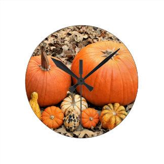 Pumpkins In Leaves Round Clock