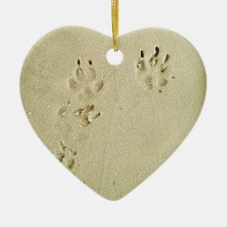 Puppy prints in the sand ceramic heart ornament