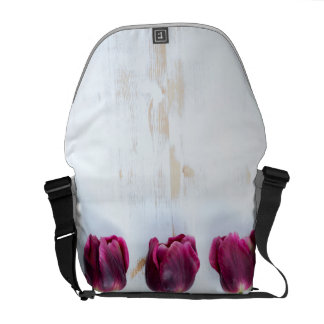 PUR-polarize tulips on white rustic wooden backgro Courier Bags