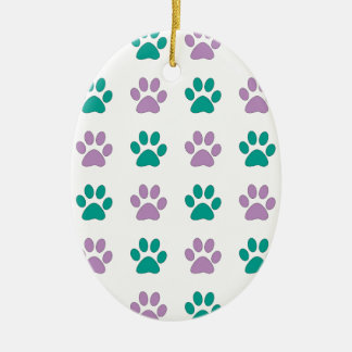 Purple and teal puppy paw prints ceramic oval ornament