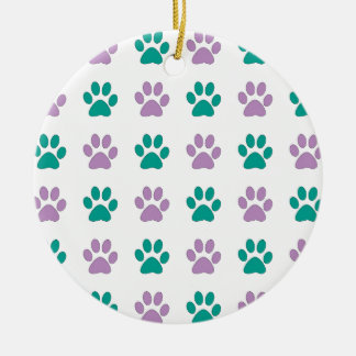Purple and teal puppy paw prints round ceramic ornament
