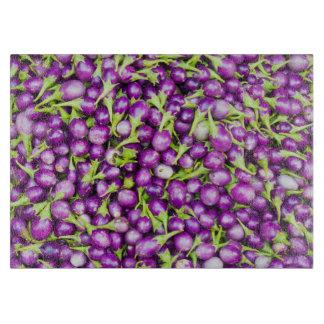 Purple aubergines cutting board