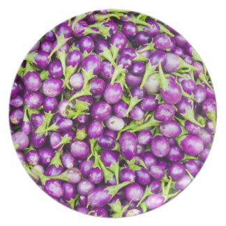 Purple aubergines plate