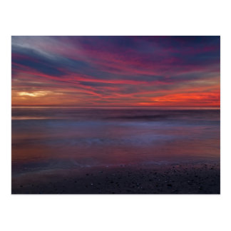 Purple-colored sunrise on ocean shore postcard