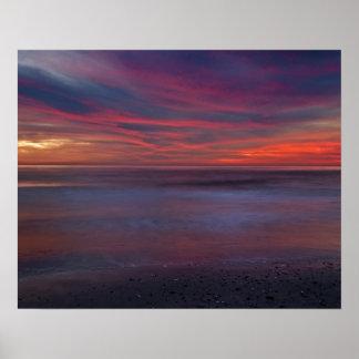 Purple-colored sunrise on ocean shore poster