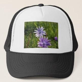 Purple daisy flowers on green background trucker hat