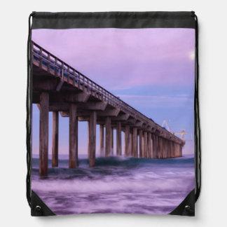 Purple dawn over pier, California Drawstring Bag