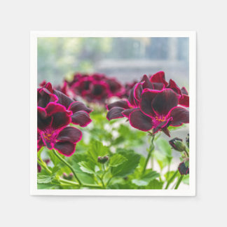 Purple flowers in and out of focus disposable napkin
