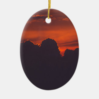 Purple orange sunset clouds ceramic oval ornament